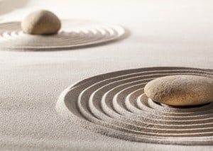 zen balance with stones and sand